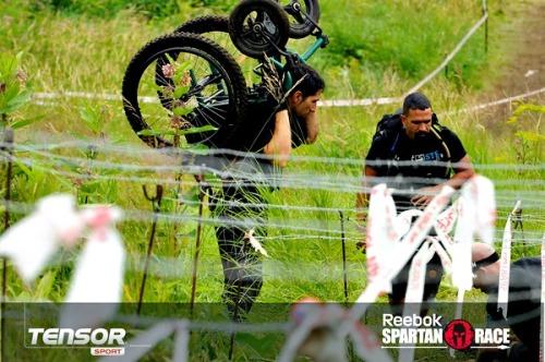wheelchair under barbed wire